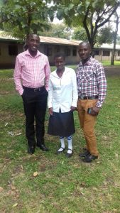 Sharon with Moris, Kasese Team Manager (right) and Patrick, Uganda General Manager (left).