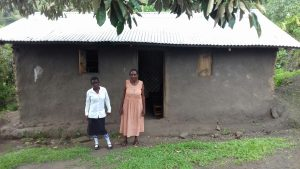 Sharon with her mother outside their home.