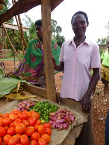 HEAL member selling tomatoes