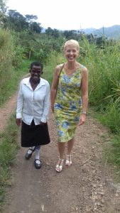 Hilary (right) with Sharon, a Peer Educator in Kasese