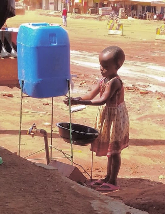 Young Girl washing her hands in Mayuge, Eastern Uganda